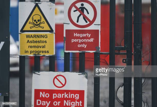 Warning and safety signs seen on a construction gate in Dublin's city center On Friday April 13 in Dublin Ireland