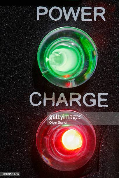 Warning lights, charger, green, red, macro