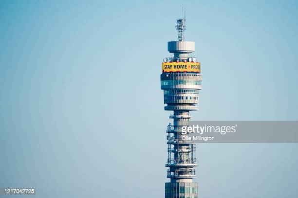 Warning messages for the public seen on the BT Tower viewed from Primrose Hill on April 5, 2020 in London, England. The British government announced...