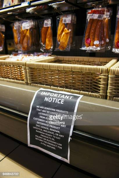 A warning notice displaying information regarding withdrawn processed meat products due to the listeriosis outbreak hangs in the refrigerated goods...