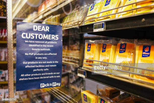 A warning notice displaying information regarding withdrawn products due to the listeriosis outbreak hangs in the refrigerated goods aisle inside a...