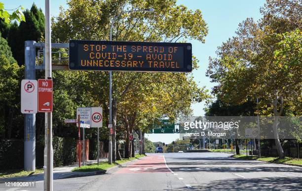 Warning road signs to avoid travel and stay at home on a main road in Neutral Bay on April 05 2020 in Sydney Australia The Australian government has...