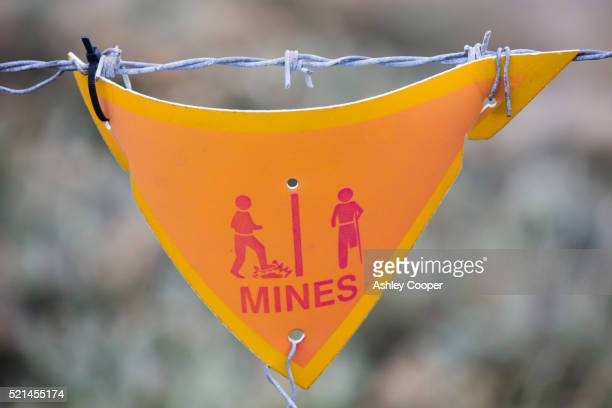 a warning sign about the presence of argentinian mines on the falklands - falklands war stock pictures, royalty-free photos & images