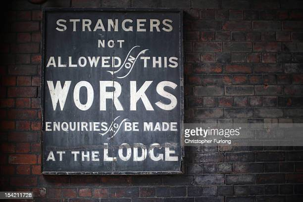 Warning sign adorns a wall at the historic Middleport Pottery as the process of moving thousands of pottery moulds gets underway on October 16, 2012...