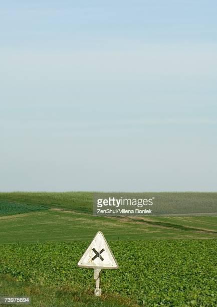 warning sign and field of crops - x art stock-fotos und bilder