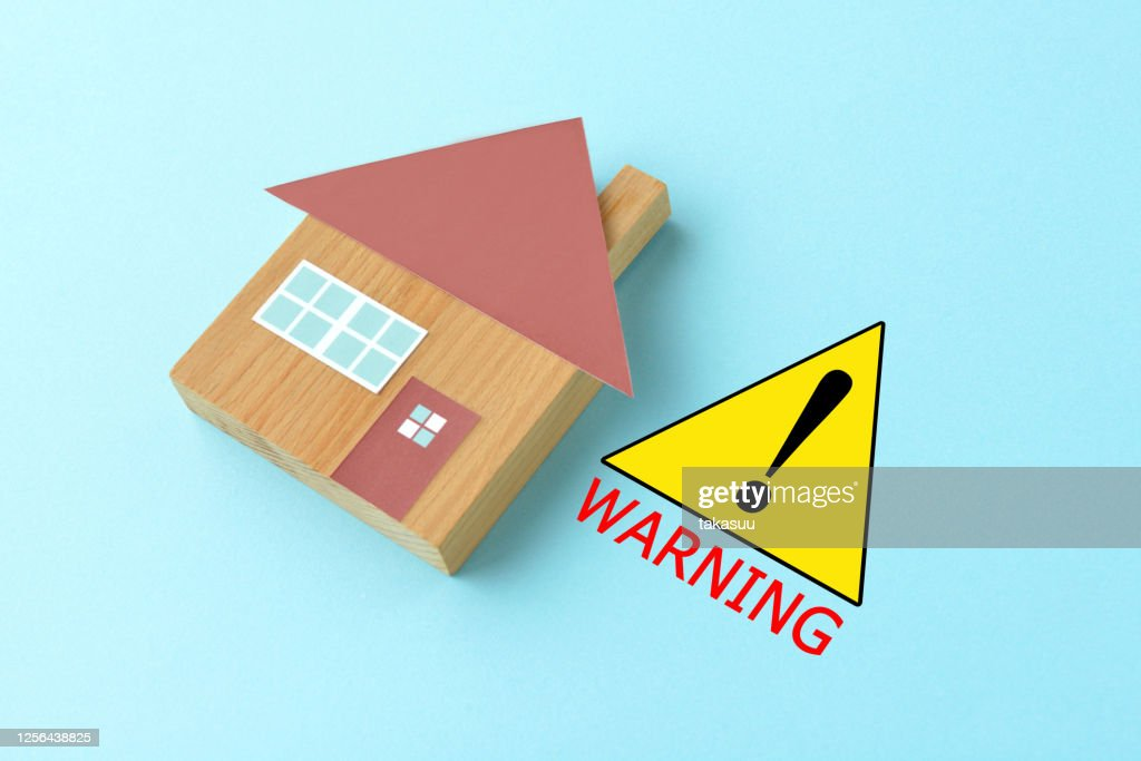 Warning sign and house object on light blue background : Stock Photo