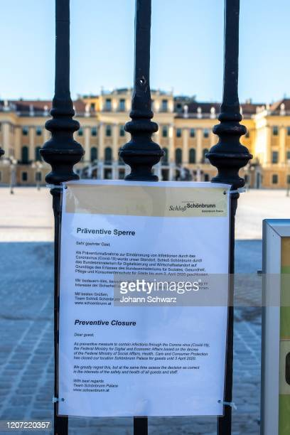 Warning sign and information on the door of Schloss Schoenbrunn about the COVID19 measures on March 15 2020 in Vienna Austria