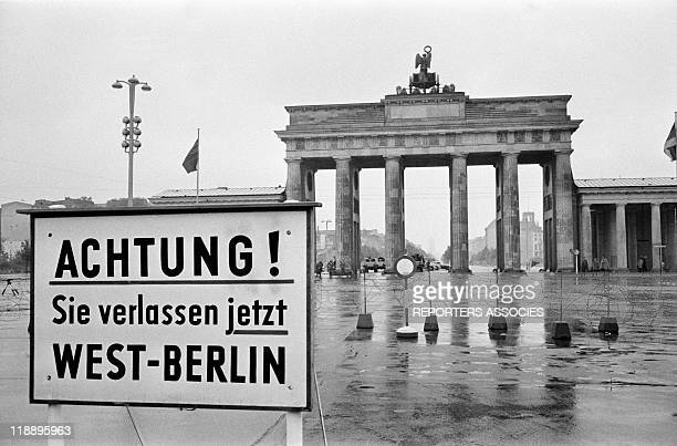 A warning sign at Brandenburg Gate during Mayor of Berlin Willy Brandt's speech after the beginning of construction of the Berlin Wall on August 16...