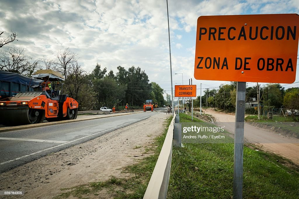 Warning Sign By Road : Stock Photo