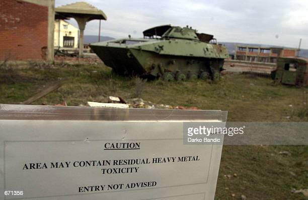 A warning sign cautions Area May Contain Residual Heavy Metal Toxicity Entry Not Advised January 12 2001 in Klina Kosovo at one of 112 sites where...