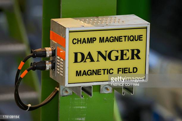 A warning sign hangs at the European Organisation for Nuclear Research Large Hadron Collider during maintenance works on July 19 2013 in Meyrin near...