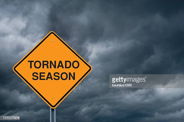 Warning Sign In front of Storm Clouds