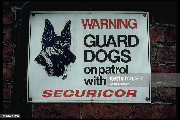 warning sign indicating guard dogs - gipstein stock pictures, royalty-free photos & images