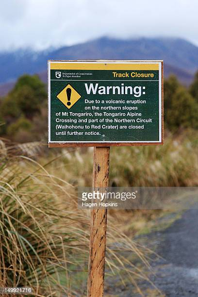 A warning sign is displayed at a road block on the Tongariro Alpine Crossing entry road after Mt Tongariro erupted for the first time in over 100...