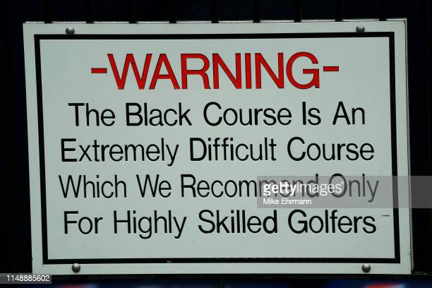 A warning sign is displayed during a practice round prior to the 2019 PGA Championship at the Bethpage Black course on May 13 2019 in Bethpage New...