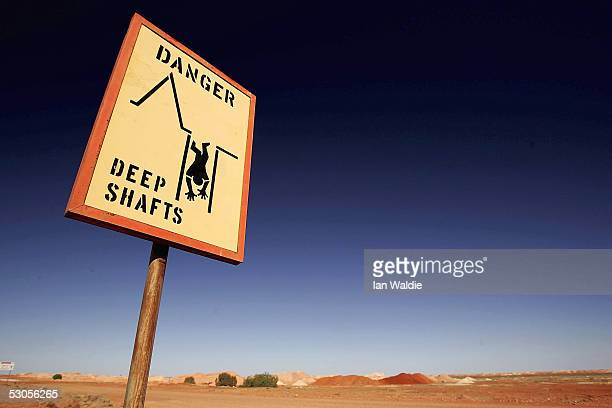 A warning sign is displayed June 12 2005 in the outback mining town of Coober Pedy Australia Australia supplies 95 percent of the world's opal supply...