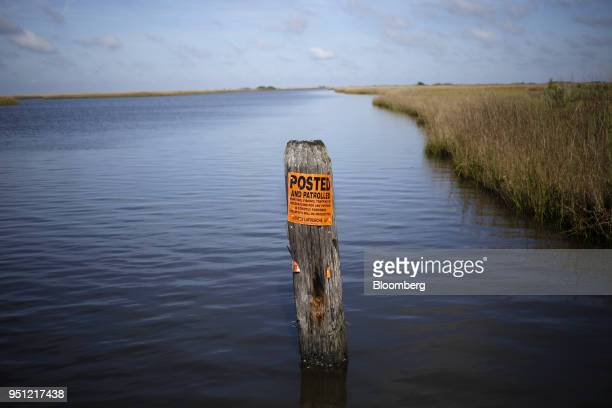 A warning sign is displayed on a post erected by private landowners ti block public access to waterways in the saltwater wetlands near Grand Isle...