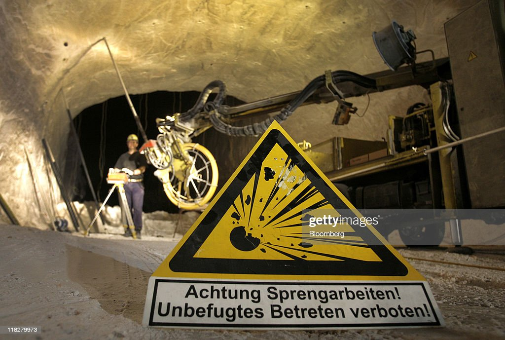 A warning sign is seen as an employee plants explosives at the K+S AG potash mine in Unterbreizbach, Germany, on Tuesday, July 5, 2011. K+S AG, Europe's biggest potash producer, dropped 1.3 percent to 53 euros and Yara International ASA, the largest maker of nitrogen fertilizers, slid 4.2 percent to 303.70 kroner as a U.S. Department of Agriculture report showed that U.S. grain acreage and inventories topped analysts' estimates. Photographer: Hannelore Foerster/Bloomberg via Getty Images