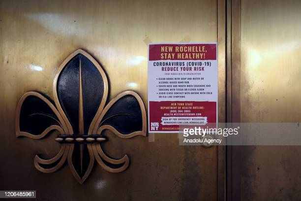 A warning sign is seen at the New Rochelle City Hall's entrance in New York United States on March 10 2020 Westchester County in New York will be...