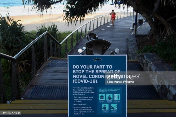 Warning sign is seen at the popular Mooloolaba main beach on March 31, 2020 in Mooloolaba, Australia. Public gatherings are now limited to two people...