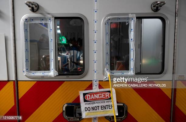 A warning sign is seen on an ambulance as it undergoes a decontamination at the Washington DC Fire and Emergency Medical Services Department's...
