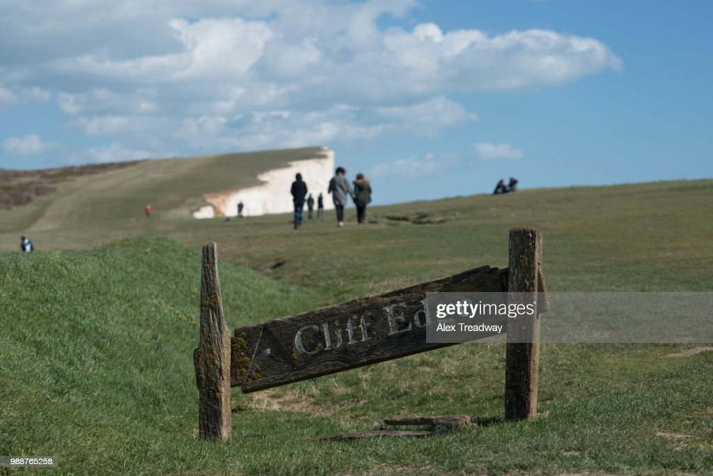 A warning sign near the cliffs at Beachy Head on the south coast, South Downs National Park, East Sussex, England, United Kingdom, Europe : Stock Photo