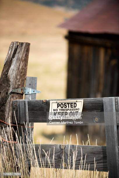 Warning sign on a building site fence, Oregon.