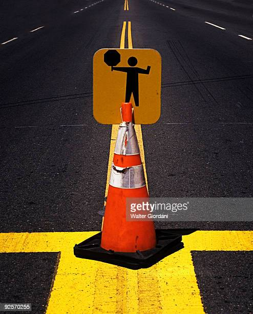 Warning sign on a cone