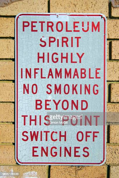 warning sign stating 'petroleum spirit. highly inflammable. no smoking beyond this point. switch off engines.' - flammable stock photos and pictures