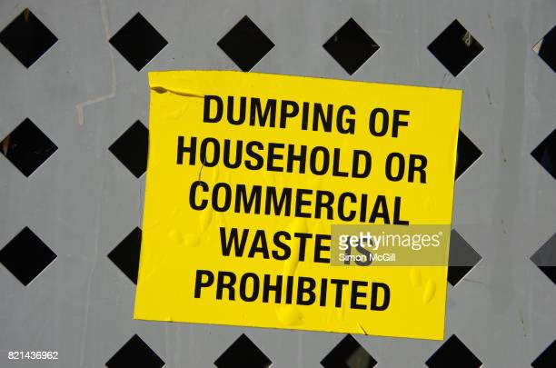 Warning sign sticker on the side of a garbage bin at a suburban shopping centre in Canberra, Australian Capital Territory, Australia