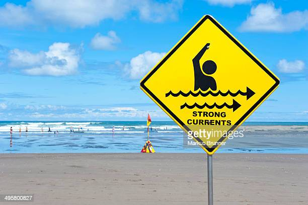 Warning sign strong currents, on a beach, Muriwai Beach, West Coast, Auckland, Auckland Region, New Zealand
