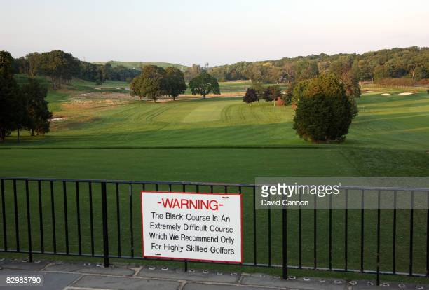 A warning sign welcomes golfers who dare beside the tee on the par 4 1st hole on the Black Course at Bethpage State Park venue for the 2009 US Open...