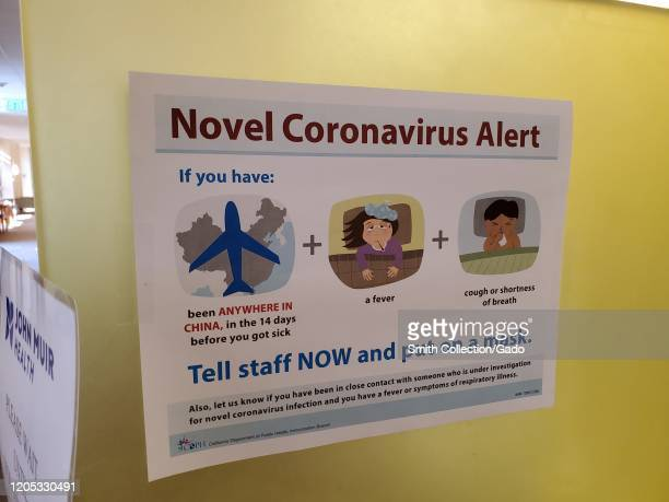 Warning sign with text reading Novel Coronavirus Alert referring to quarantine and screening procedures for patients with possible exposure to a...