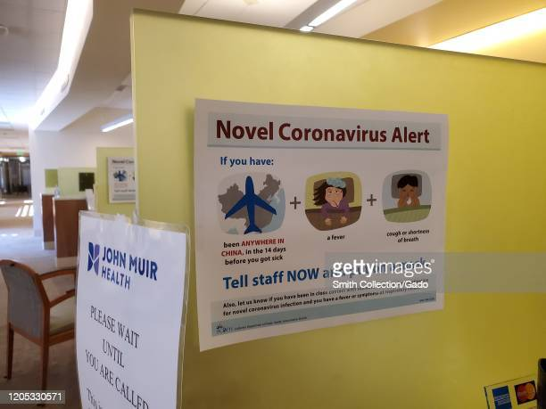 """Warning sign with text reading """"Novel Coronavirus Alert"""", referring to quarantine and screening procedures for patients with possible exposure to a..."""