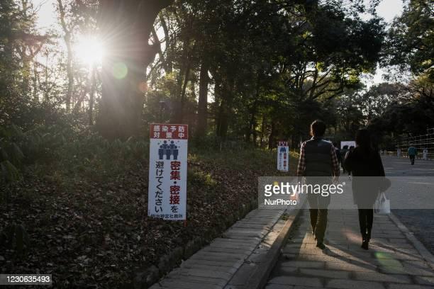 Warning signboards for CoronaVirus line up at Meiji Shrine in Tokyo, Japan on 16 January 2021.