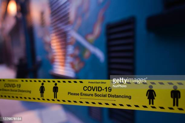 Warning tape, COVID-19 - Please Ensure Social Distancing, seen in Dublin's city centre. On Wednesday, November 18 in Dublin, Ireland.