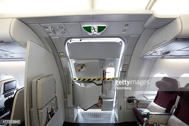 Warning tape sits across the semi open passenger access door of an Airbus SAS A380 aircraft operated by Qatar Airways Ltd on day two of the 51st...