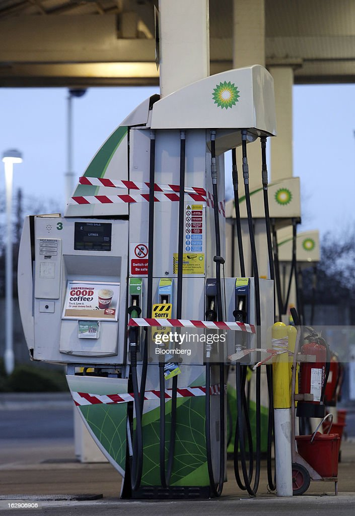Warning tape stops customers from using gas and diesel fuel nozzles on the forecourt of a BP gas station, operated by BP Plc, in Upminster, U.K., on Thursday, Feb. 28, 2013. BP Plc's push to maximize profits and cut costs at the Macondo well was a 'root cause' of the explosion that led to the 2010 Gulf of Mexico oil spill, a safety expert who studied the disaster said. Photographer: Chris Ratcliffe/Bloomberg via Getty Images