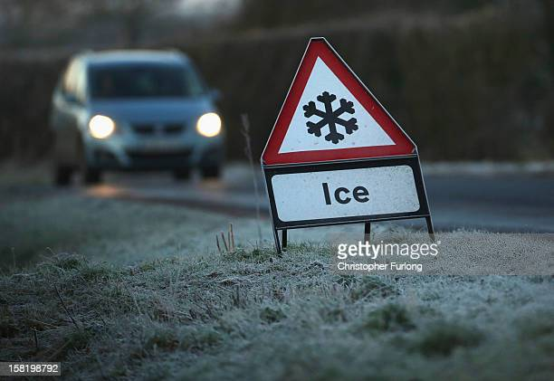 A warning triangle alerts drivers to an icy road on December 11 2012 in Knutsford England Forecasters are warning that the UK could experience the...