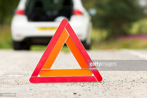 Warning triangle on road used for automobile breakdown