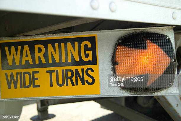 """""""warning wide turns"""" sign on truck - vehicle light stock pictures, royalty-free photos & images"""