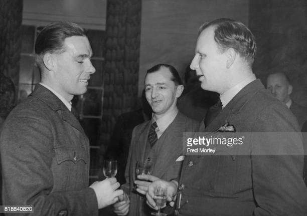 Warrant Officer R W Green an escaped prisonerofwar talks to Squadron Leader Roderick Alastair Brook Learoyd VC at the second lunch of the RAF Line...