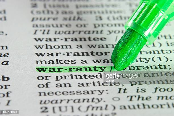 warranty definition highligted in dictionary