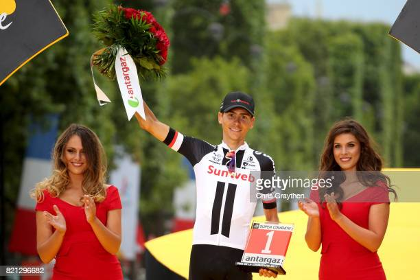 Warren Barguil of France riding for Team Sunweb celebrates on the podium after winning the most aggressive rider award of the 2017 Le Tour de France...