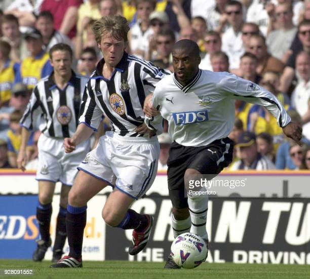 Warren Barton of Newcastle United challenges Dean Sturridge of Derby County during the FA Carling Premiership match between Derby County and...