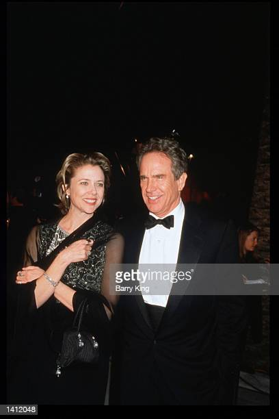 Warren Beatty and Annette Bening attends the Vanity Fair Oscar party March 21 1999 in Los Angeles CA The party organized by Vanity Fair magazine is...