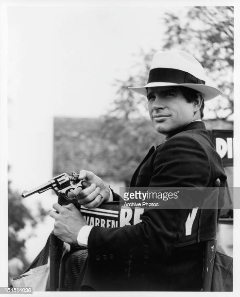 Warren Beatty holds a pistol in a promotional portrait for the film 'Bonnie And Clyde' 1967