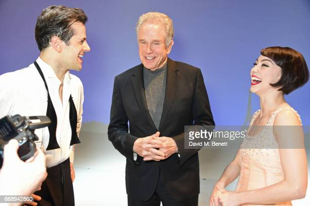 Warren Beatty poses backstage with cast members Robert Fairchild and Leanne Cope of the West End production of An American In Paris at the Dominion...