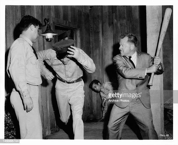 Warren Berlinger gets needed assist from Mickey Rooney as Jimmy Boyd and Conway Twitty flee after giving Berlinger some rough treatment in a scene...