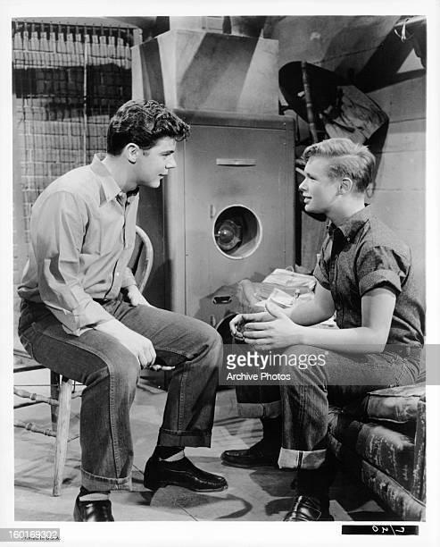 Warren Berlinger talks with Brandon De Wilde in a scene from the film 'Blue Denim' 1959
